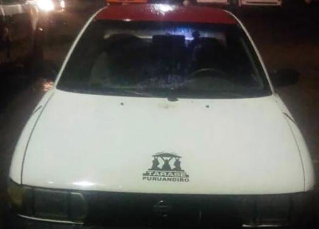 Taxi con conductor armado